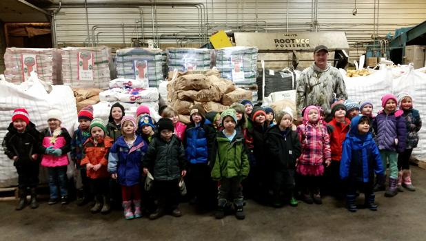 Plummer and Oklee School Readiness students pictured with Isaac Magnell during their field trip to Peatland Reds.