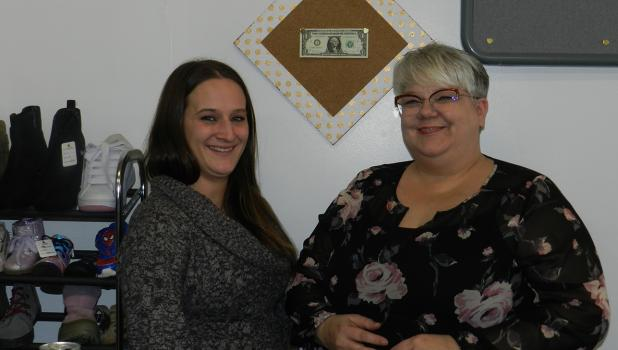 """Jess and Michelle proudly show off their first dollar earned at the store. One of their goals is to give back to the community. """"Pursue your dreams, you're never too old!"""""""