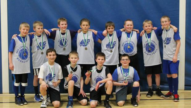 Isiah Olson >> Rebels Boys Basketball teams took first place at tournaments | Richards Publishing