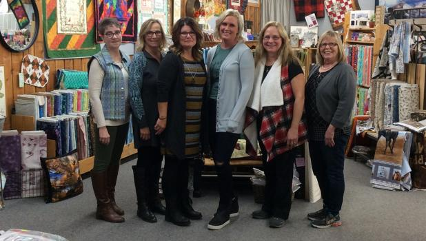 The staff at Oklee Quilting include Judy Schue, Cheryl O'Neill, LeAnn Smith (owner) Amanda Nelson, Toni Johnson (owner) and Sandra Tougas. Not pictured: Jess Knutson.