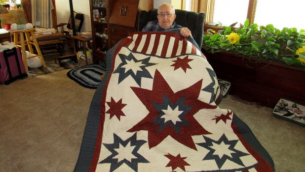 Jim Paulson from Trail was the recipient of a beautiful, handmade quilt, which was made by the East Polk County Quilts of Valor volunteers.
