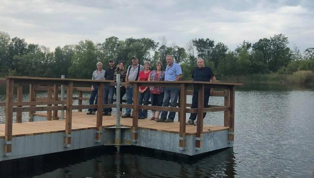 Members of the Fourtown/Grygla Sportsman's Club met with members of the Beltrami County District 4 Con Con Citizen Committee last Monday evening on the new fishing pier out at the pit. L-R: Jack Nelson, Robert & Kari Sundberg, Ray Benson, Jean Foss, Denise & Blair Holthusen and Ray Hendrickson. Photo by Grygla Eagle Newspaper