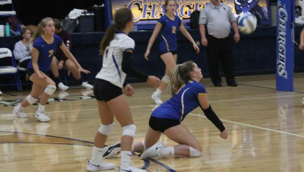 Jennah Henrickson works to get the ball up to the setter! Photo by Grygla Eagle Newspaper