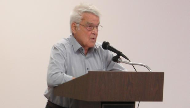 Rev. Theo Scheytt speaking at the McIntosh Memorial Day program in 2018.