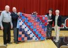 Norman Nelson (far left) was presented a quilt by the TRF Quilters Guild in honor of his service to the county. Also pictured are Commander Rick Dulka, Shirley Dessellier from the Quilter's Guild and Norman's wife, Ione Nelson.