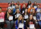 RLCC volleyball players with their Spotlight on Scholorship awards. Front: Hannah Kolstoe and Megan Smith. Second row: Julia Bernstein, Sarah Christensen, Hannah Riendeau, Sydnie Gunderson, Jenna Pahlen, and Lacey Pendelton. Third row: Jayden Iverson, Sophia Linder, Calyssa Eskeli, Brandie DeHate, and Sidney Olson. Back: Karena Melby, Emily Kolstoe, Katelyn Suchy, Janae Olson, and Kia Bachand.