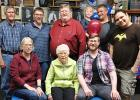 Mike Swenson and family celebrated his retirement after a long, successful teaching career. Family members with him included: (Seated) Kaylynn Wold, his mother Joyce, and Andy. (Standing) Tom Wold, Paul, Mike, Adam holding Aubrey, and Landon.
