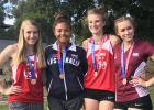 RLCC'S Julia Bernstein (second from left) had an awesome opportunity to compete in track at DownUnder in Brisbane Australia. She and her relay teammates are pictured with their third place medals.