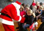 Santa Claus Day in Trail had all the children drawing on the chalk board at the old school. Santa also made his appearance and children were drawing for prizes that were donated.