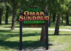 """During Market Day last year Scott Sundrud and Jack Sundrud were presented with the honor of naming the Oklee North Park, the """"Omar Sundrud Memorial Park"""". This is the new sign that is now in the park."""