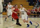 #20 Morgan Burns and #34 Carlye Kiesow in the game against RLCC last week at the Northland Holiday Basketball Tournament. Chargers got a 53-51 victory this game.